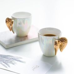 Creative White Ceramic Mug Gold Plated Handle Angel Wings Office Home Coffee Milk Porcelain Mugs Couple Gift Home Decoration – Home & Garden Pretty Mugs, Cute Mugs, Ceramic Coffee Cups, Coffee Mugs, Coffee Latte, Coffee Lovers, Mugs Sharpie, Mug Diy, Cerámica Ideas
