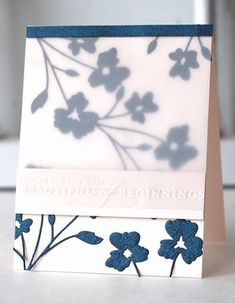 layer vellum over a die cut and stamp sentiment with white pigment ink then emboss with white powder.  How pretty is this card?!