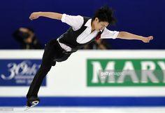 Takahiko Kozuka of Japan performs during the men's short program of the 2015 ISU World Figure Skating Championships at Shanghai Oriental Sports Center in Shanghai, on March 27, 2015. AFP PHOTO / JOHANNES EISELE