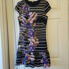 Really pretty Muse striped floral dress Really pretty Muse dress Navy Blue with Black & White stripes with contrasting flower pattern. Drop waist with flare hem. Hidden zipper in back really cute on worn twice Dresses Asymmetrical