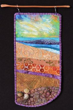 Everyday at the Beach is Different # 4. A small art quilt by Eileen Williams