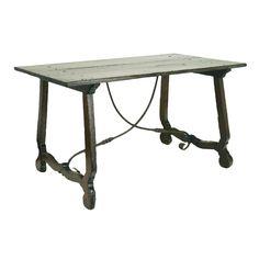An Italian Baroque Walnut Trestle Table with Iron Stretcher
