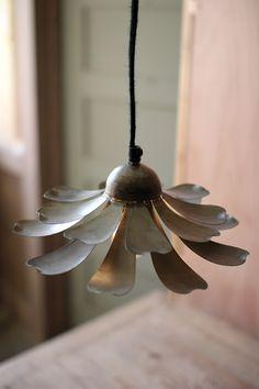 raw metal flower pendant