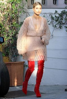 In the nude!Hailey wore kinky red thigh high boots with a flouncy nude dress, featuring s...