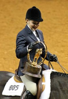 "Katerina Mendel and ""Willys on the green"" World Champion Hunter Under Saddle Horse. AQHA Youth World Show 2013.  We are so proud of Katerina, one of our favorite exhibitors that show the ShoMe Shows. Congrats to Katerina, her trainer Rosie Sheffer for a proud and memorable moment!   Photo: Equine Chronicle"