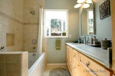 One Week Bath transformed this space into a transitional bathroom with a lovely alcove window. This bathroom remodel features both contemporary and traditional styles, including a step-in shower and tub combo. This bathroom design is well suited for those who like to mix styles. #OneWeekBath #Bathroom #Remodel