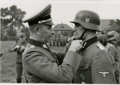 "SS-Gruppenfuehrer und Generalleutnant der Waffen-SS Paul ""Papa"" Hausser, the ""father"" of the Waffen SS, decorates SS-Untersturmführer Ludwig Kepplinger with the King's Cross of the Iron Cross for gallantry during the invasion of France. Kepplinger, who was severely wounded twice, reached the rank of SS-Sturmbannführer and was killed  in Villiers-Charlemagne, France, on Aug 6, 1944."