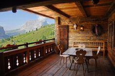 I love this European flavored patio/porch. Check out the views. Wow!