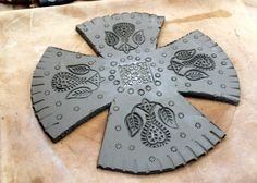 slab. template. stamping texture/pattern. score/slip into bowl.