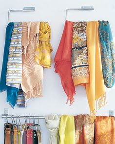 I especially like the s hook belt storage idea.  Make Accessories Easy to Identify  Make scarves, belts, and other accessories easy to find in your closet. Rather than stuff them into one big bin, hang scarves on a pair of paper-towel holders mounted on the inside of one closet door to keep them neat and wrinkle-free. A kitchen-utensil rail proves to be ideal for belts: Each gets its own S hook.
