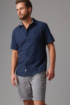 Cut in our regular fit in a breezy lightweight cotton this shirt features a subtle all over bike print. Featuring a left chest pocket, contrast trims and a box pleat in the back for added comfort. We've finished this shirt with branded Wild South buttons and woven shirt tag. Available in navy or chambray blue.