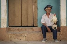 Taken in Trinidad, Cuba, a man and his chicken looks out into the world.