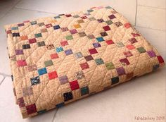 Single Irish Chain Charm Patchwork Quilt - I love this, scrappy jewel tone squares on a tan background from Kansas Troubles, with simple grid quilting.