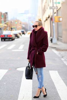 Shop this look for $120: http://lookastic.com/women/looks/burgundy-overcoat-and-black-shopper-handbag-and-light-blue-jeans-and-black-heels/908 — Burgundy Coat — Black Tote Bag — Light Blue Jeans — Black Pumps