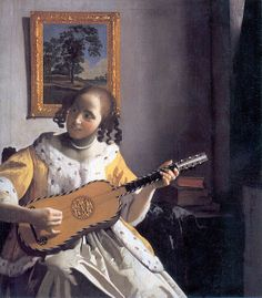 A young woman playing guitar painted by Jan Vermeer around 1670