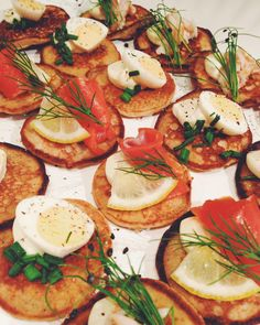 Tonight's appetizers for this years first Christmas dinner: buckwheat blini's with smoked trout, salmon and quail eggs. We also made mackerel salad and endive bites and goat cheese smokes almond balls with red wine poached grapes #christmas#catering#emmakookt#partyfood#blinis#christmasdinner