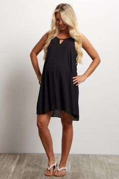 Step up your basics with this maternity mini dress. A flowy chiffon material to comfortably show off your belly from week to week, and a cutout front detail for style. Pair this dress with your favorite heels and a statement necklace for a romantic look that's perfect for date night.