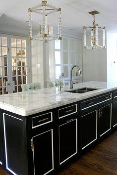 design manifest kitchen island with mirrored pantry