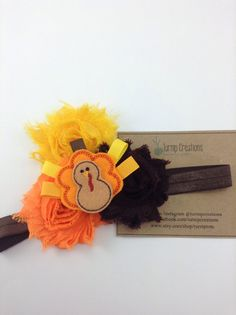 Gobble...Gobble! The perfect Thanksgiving Headband...a fun felt turkey with grosgrain ribbon feathers paired with 3 matching shabby flowers in all the