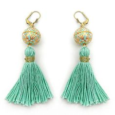 Trendy Mint Tassel Earrings With An Unusual Mint White and gold Handpaited Brass Cloisonne bead.  Liven up your day with these funky tassel earrings! The focal unit of these boho tassel earrings comprise of a unique large brass cloisonne bead that is hand painted with a pretty tribal pattern in mint and white and handmade pure cotton mint colored tassels with a gold wrap.The earring backs are dull gold plated brass lever backs (pls let me know if you have a preference with respect to ear…
