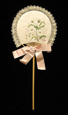 Fixed fan  Date:     1880–89 Culture:     American Medium:     Wood, silk, cotton Dimensions:     15 3/4 in. (40 cm) Credit Line:     Brooklyn Museum Costume Collection at The Metropolitan Museum of Art, Gift of the Brooklyn Museum, 2009; Gift of Craig Hammitt in memory of Mr. and Mrs. Walter Hammitt, 1957 Accession Number:     2009.300.4982