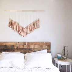 This+wall-hanging+is+beautiful+and+will+add+depth+and+character+to+any+space.++Handmade,+painted+strips+of+fabric+hang+from+a+wooden+dowel+rod+with+a+rya+knot.++ Dimensions: Large:+48''+wide+(dowel+rod)+X+30''+length+(from+dowel+rod+to+lowest+point) Small:+24''+wide+(dowel+rod)+X+15''+length...