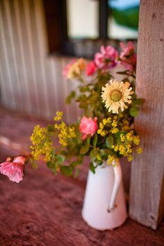 Flowers in enamel jugs at Fforest, Wales