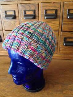 Ravelry: penandra's Lovely Leftovers -- I made this hat with leftover sock yarn in my stash (At least five different pairs of socks are represented in this hat). I used two strands together throughout.  I love this hat!