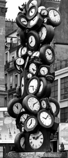A sculpture of clocks. This would be a great piece for the clock fanatic.
