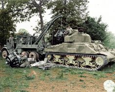 "Engine change for M4 Sherman tank ""Hurricane"" at a repair depot near the front Normandy 1944"