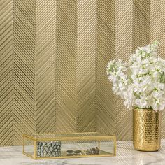 You'd think a petite gold chevron mosaic would be busy, but it just reads as a very luxurious wallpaper. Simply divine.