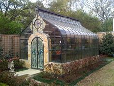 Greenhouse with stained glass door #steampunktendencies #steampunk #architecture #victorian #artnouveau #glasshouse #greenhouse #amazing #beautiful