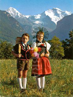 Swiss CHILDREN Jungfrau Switzerland. (Old image of children in traditional Swiss dress. Jungfrau, Swiss alps, approximately 1960.)