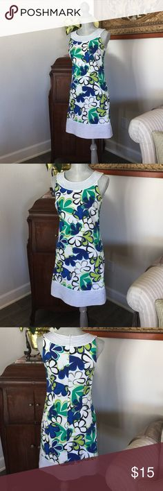 Vintage flirty flowery fabulous Dress Nygard collection special find perfect for summer garden party! It's a must have absolutely perfect please note that there is some discoloration on the back by the zipper see last photo looks as though the blue flower bleed a little ..96% cotton 4% spandex Nygard Collection Dresses Midi