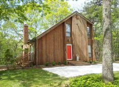 Saltbox. Traditionally a new England look. Long roof sloping down. Can be seen with a cat slide.