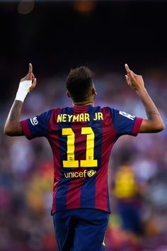 Neymar of FC Barcelona celebrates after scoring his team's fifth goal during the La Liga match between FC Barcelona and Granada CF at Camp Nou on September 27, 2014 in Barcelona, Catalonia.
