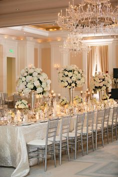 love the hanging chandeliers and cream flowers and table cloth
