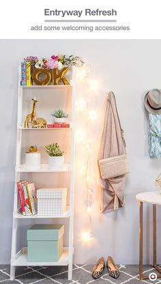 Style your entryway like a room: Liven up a simple bookshelf with Oh Joy! for Target decorative accents, like the party animal figurines and OK vase set, or drape the Dotty String Lights over a storage hook to create a welcoming warmth.