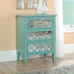 Three drawers feature geometric, mirrored design. Solid wood legs. Seafoam Green finish.