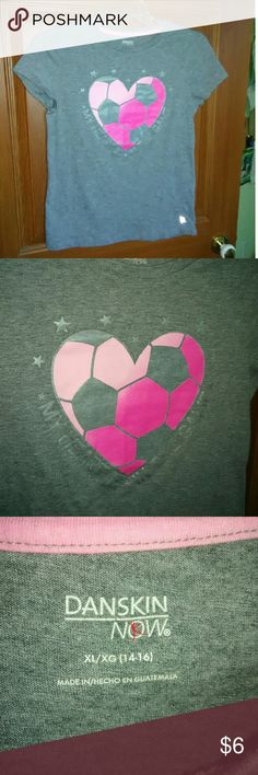 "Girls Soccer Shirt Gray heathered,with heart shaped soccer ball on front. Says "" MY HEART IS IN THE GAME"" Has gray stars around heart. It's a Dri-More shirt. Feel free to ask for more information or pictures!! Danskin Now Shirts & Tops Tees - Short Sleeve"