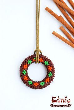 spec-holder #necklace Occhiondolo Etnic - green and orange