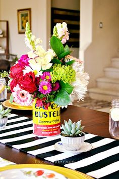 colorul flower arrangement in a repurposed coffee can <3