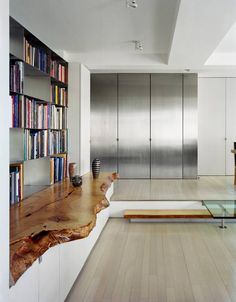 Live-edge shelving and countertops are pieces made from aged wood slabs with their natural edges and curves left untouched; 'it never fits in the elevator'
