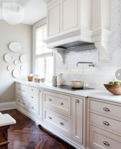 Pristine. Classic. Fresh. Timeless. Color trend with traction.  It seems the love affair between kitchen design and decorating and the very right of the wh