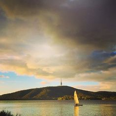 We adore this photo by Instagrammer @juddalicious of our Lake Burley Griffin at dusk. Pastel colours dramatic clouds and a solitary sail boat  whats not to love? #visitcanberra by visitcanberra