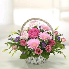 Easter floral arrangement Gift of flowers - same day delivery. Standard sized basket in 'Soft' colours (other choices available). Basket Flower Arrangements, Beautiful Flower Arrangements, Floral Arrangements, Beautiful Flowers, Easter Flowers, Mothers Day Flowers, Spring Flowers, Silk Flowers, Flower Basket
