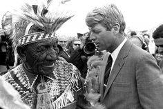 Alfred Pilsmore, left, 84-year-old Oglala Sioux Indian, discusses Indian needs with Robert F. Kennedy at the poverty-ridden Calico Indian village on the Pine Ridge Indian Reservation in South Dakota, April 16, 1968.
