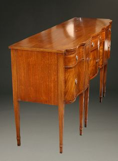 Exquisite Antiques: This wonderful circa 1940 Sheraton style mahogany sideboard is attributed to Romweber, a furniture maker once located in Batesville, Indiana. Learn more about this lovely piece: http://www.beauchampantiques.com/inventory/romweber-sheraton-style-hunt-board-circa-1940/ #antiques