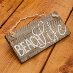 """Beach life Beach decor Rustic beach sign Beach wall decor Beach house decor Wood wall art Pallet sign Rustic wood sign Wood decor sign   • Handcrafted and painted by North Carolina artisans • Created with naturally distressed, reclaimed wood • Provides a rustic accent for any beach-themed room • Dimensions: 12"""" x 5.5"""" *This item is made to order. Some variation in color will occur depending on the wood available. Beach life- the ocean, sunshine, and sand between your toes!  Handcrafted with…"""