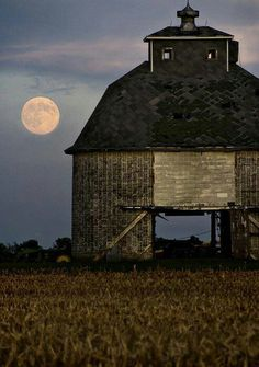 Old barn and full moon